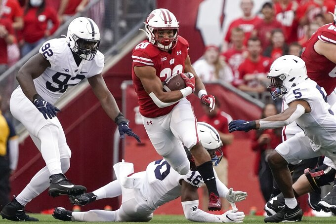 Wisconsin's Isaac Guerendo runs for a first down during the first half of an NCAA college football game against Penn State Saturday, Sept. 4, 2021, in Madison, Wis. (AP Photo/Morry Gash)