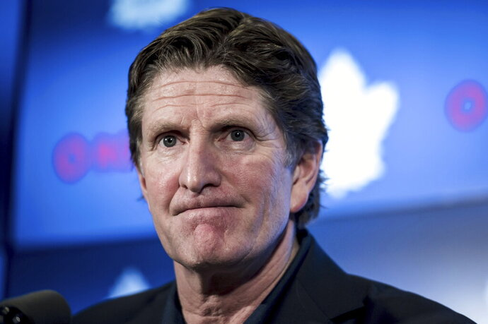 FILE - In this April 25, 2019, file photo, Toronto Maple Leafs coach Mike Babcock speaks to reporters in Toronto. The Maple Leafs fired Babcock on Wednesday, Nov. 20, 2019, and replaced him with Sheldon Keefe. (Christopher Katsarov/The Canadian Press via AP, File)