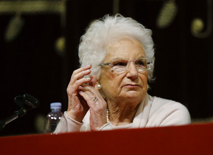 Holocaust survivor Liliana Segre speaks with young students on the occasion of an Holocaust remembrance, at the Arcimboldi theatre in Milan, Italy, Wednesday, Jan. 24, 2018. Segre, a senator for life, unwittingly provoked one of Italy's most intense confrontations with anti-Semitism since the fall of the Fascist dictatorship when she proposed a motion to create a parliamentary commission against anti-Semitism which the center-right abstained from voting. (AP Photo/Luca Bruno)
