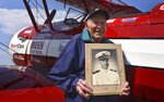 Kenneth Schrammeck, 98, took to the skies for a flight in a Boeing-Stearman Model 75 biplane at Glacier International Airport on Thursday, Aug. 26,2021, for the first time since training in one as a Navy aviator during World War II. The flight was part of nonprofit Dream Flights' Operation September Freedom, which honors World War II veterans. (Jeremy Weber/Daily Inter Lake via AP)