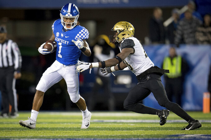 Kentucky wide receiver Lynn Bowden Jr. (1) runs past Vanderbilt defensive back Allan George (28) during the second half of an NCAA college football game in Lexington, Ky., Saturday, Oct. 20, 2018. Kentucky won, 14-7. (AP Photo/Bryan Woolston)