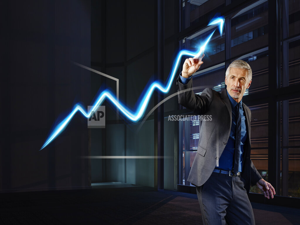 Businessman painting the stock market development with light