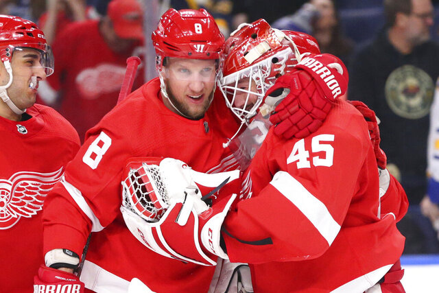 Detroit Red Wings forward Justin Abdelkader (8) and goalie Jonathan Bernier (45) celebrate a victory over the Buffalo Sabres following a shootout of an NHL hockey game Thursday, Feb. 6, 2020, in Buffalo, N.Y. (AP Photo/Jeffrey T. Barnes)