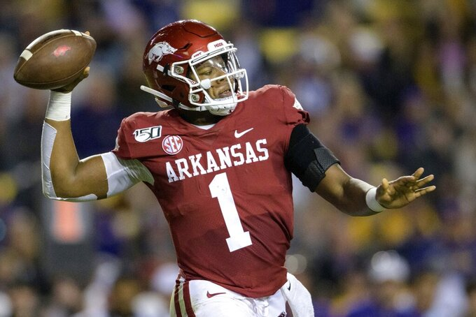Arkansas quarterback K.J. Jefferson (1) throws a pass against LSU during the first half of an NCAA college football game in Baton Rouge, La., Saturday, Nov. 23, 2019. (AP Photo/Matthew Hinton)