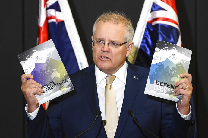 Australian Prime Minister Scott Morrison speaks during the launch of the 2020 Defence Strategic Update in Canberra, Wednesday, July 1, 2020. Morrison is announcing 270 billion Australian dollars ($190 billion) in additional defense spending over the next decade which will include long-range missiles and warned that the post-pandemic world will become more dangerous.(Lukas Coch/AAP Image via AP)