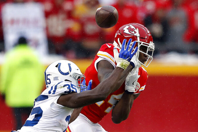 Indianapolis Colts cornerback Pierre Desir (35) breaks up a pass intended for Kansas City Chiefs wide receiver Sammy Watkins (14) during the first half of an NFL divisional football playoff game in Kansas City, Mo., Saturday, Jan. 12, 2019. (AP Photo/Charlie Neibergall)