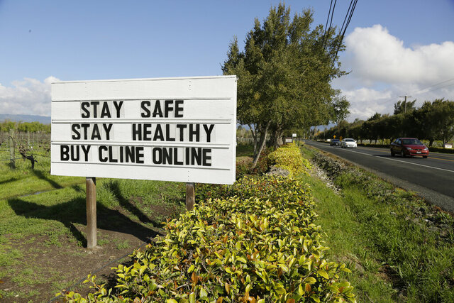 A sign outside the Cline Cellars winery urges motorists on Highway 121 to be safe and buy online Thursday, March 19, 2020, in Sonoma, Calif. The winery is closed because of the coronavirus threat. As worries about the spread of the coronavirus confine millions of Californians to their homes, concern is growing about those who have no homes in which to shelter.(AP Photo/Eric Risberg)