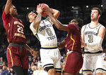 Georgia Tech guard Michael Devoe (0) battles Bethune-Cookman guard Wali Parks for the ball under the basket during an NCAA college basketball game Sunday, Dec. 1, 2019, in Atlanta. Bethune-Cookman guard Isaiah Bailey, left, and Georgia Tech forward Evan Cole, right, look on. (Curtis Compton/Atlanta Journal-Constitution via AP)