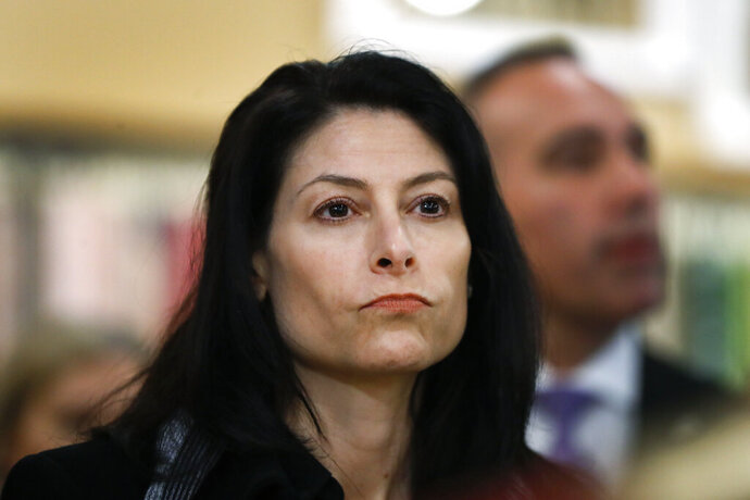 FILE - In this March 18, 2019, file photo, Michigan Attorney General Dana Nessel attends an event for Democratic presidential candidate Sen. Kirsten Gillibrand, D-N.Y., in Clawson, Mich. Nessel said Wednesday, May 22, that a Republican-enacted law making it harder to put proposals on the ballot is unconstitutional. Her opinion binds state officials unless it is reversed by a court. A legal fight is expected. (AP Photo/Paul Sancya File)