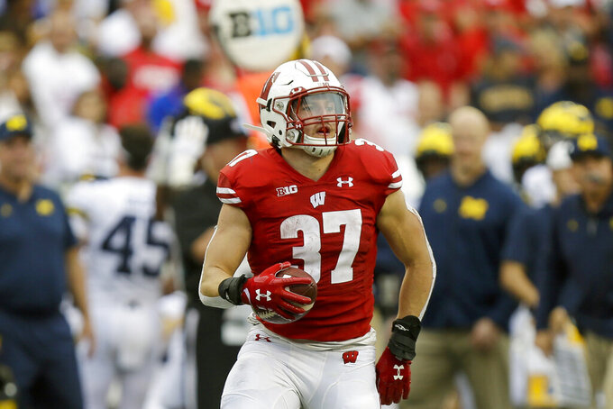 FILE - In this Sept. 21, 2019, file photo, Wisconsin running back Garrett Groshek (37) carries during the second half of an NCAA college football game against Michigan, in Madison, Wis. Wisconsin's rushing attack will look quite a bit different this season without Jonathan Taylor in the backfield. Wisconsin begins adjusting to life without Taylor on Friday night, Oct. 23, 2020, when the 14th-ranked Badgers host Illinois in their pandemic-delayed season opener. (AP Photo/Andy Manis, File)