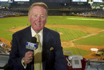 FILE - In this July 3, 2002 file photo, Los Angeles Dodgers television play-by-play announcer Vin Scully rehearses before a baseball game between the Dodgers and the Arizona Diamondbacks in Phoenix. Some of the most familiar voices have left in recent years. The Dodgers' Vin Scully _ recognized within the business as one of the best ever _ retired after the 2016 season, his 67th. (AP Photo/Paul Connors, File)