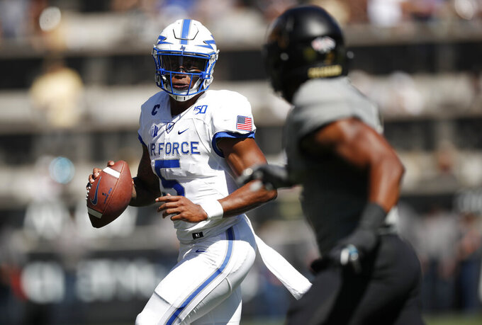 Air Force quarterback Donald Hammond III, left, is pursued by Colorado safety Mikial Onu in the first half of an NCAA college football game Saturday, Sept. 14, 2019, in Boulder, Colo. (AP Photo/David Zalubowski)
