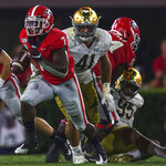 Georgia running back D'Andre Swift (7) runs the ball in the second half of a NCAA football game between Georgia and Notre Dame in Athens, Ga., on Saturday, Sept. 21, 2019 with the final score UGA 23 - Notre Dame 17. (Ken Ward/Athens Banner-Herald via AP)