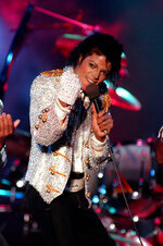 FILE - In this Dec. 3, 1984 photo, Michael Jackson performs with his brothers at Dodger Stadium in Los Angeles, as part of their Victory Tour concert. The Michael Jackson estate has sent a letter to the U.K.'s Channel 4 warning that a documentary on men who accuse the singer of molesting them as boys violates the network's programming guidelines. Estate attorneys say in the letter released to The Associated Press on Monday, Feb. 11, 2019, that