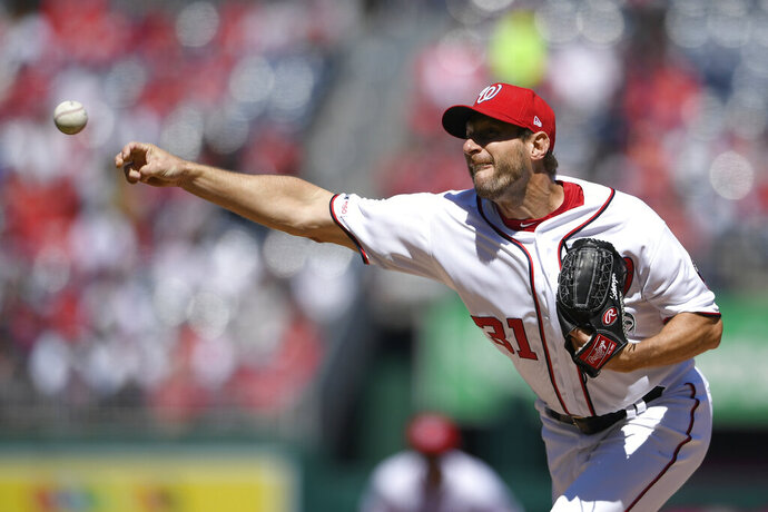 Washington Nationals starting pitcher Max Scherzer delivers a pitch during the first inning of a baseball game against the New York Mets, Thursday, March 28, 2019, in Washington. (AP Photo/Nick Wass)