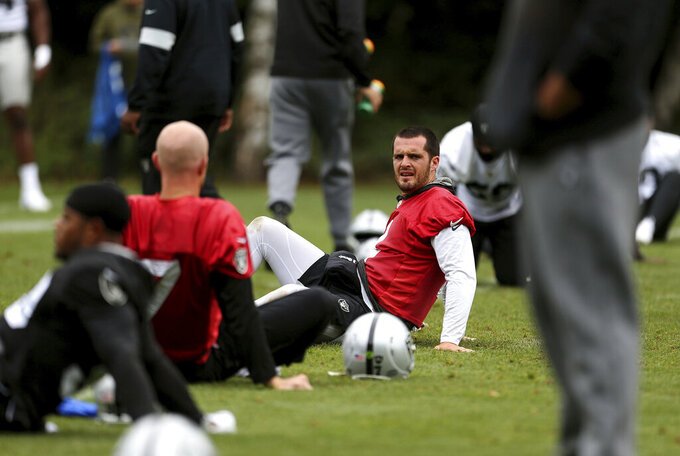 Oakland Raiders quarterback Derek Carr attends a training session during the media day at The Grove Hotel, Watford, England, Friday, Oct. 4, 2019. The Oakland Raiders are preparing for an NFL regular season game against the Chicago Bears in London on Sunday. (Steven Paston/PA via AP)