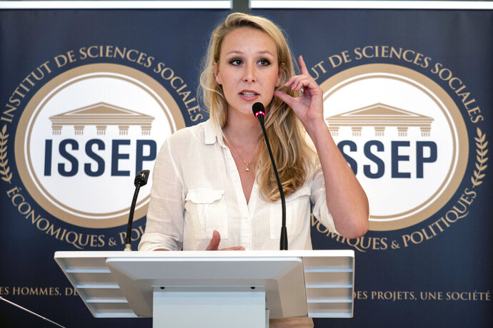 FILE - In this June 22, 2018 file photo, Marion Marechal delivers a speech as she inaugurates the Institute of Social Sciences, Economics and Politics (ISSEP) in Lyon, central France. She vowed to stay out of politics and even dropped the French far right's signature name _ Le Pen _ from her moniker. But Marion Marechal, a former star lawmaker who's still only in her 20s, is now tip-toeing back into the political arena, and is already causing trouble. Widely seen as a potential party leader, the 29-year-old's discreet meetings in recent days to build bridges with enemy conservatives are further unsettling the mainstream right. (AP Photo/Laurent Cipriani, File)