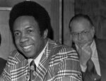 FILE - This June 19, 1996, file photo shows Frank Robinson at a news conference in Cleveland, Ohio, after being named Major League Baseball's first black manager, with the Cleveland Indians. In the background is baseball commissioner Bowie Kuhn. Hall of Famer Frank Robinson, the first black manager in Major League Baseball and the only player to win the MVP award in both leagues, has died. He was 83. Robinson had been in hospice care at his home in Bel Air. MLB confirmed his death Thursday, Feb. 7, 2019. (AP Photo/File)