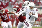 FILE - In this Nov. 18, 2017, file photo, Mississippi State quarterback Nick Fitzgerald slips past the Arkansas defense to score a touchdown during the first half of an NCAA college football game in Fayetteville, Ark. Kentucky's defense have held up their end by shutting out opponents in the third quarter in particular, but face their biggest challenge against No. 14 Mississippi State and mobile quarterback Nick Fitzgerald on Saturday. (AP Photo/Michael Woods, File)