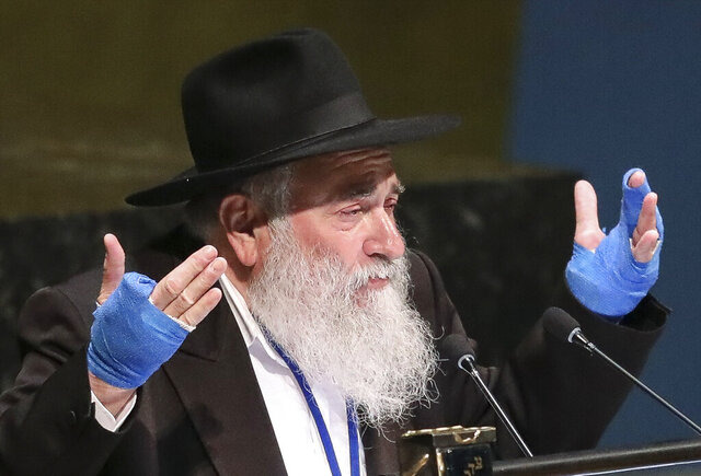 FILE - In this June 26, 2019, file photo, Rabbi Yisroel Goldstein, senior rabbi of Chabad of Poway synagogue in San Diego, Calif., addresses the United Nations General Assembly's meeting on combating antisemitism and other forms of racism and hate in the digital age at U.N. headquarters. The rabbi who had part of his hand shot off in a deadly attack at his Southern California synagogue pleaded guilty Tuesday, July 14, 2020, to federal charges of tax and wire fraud, according to a newspaper report. Rabbi Goldstein, 58, acknowledged his role in a scheme in which donors made large contributions to Chabad of Poway but then secretly got most of the money back, the San Diego Union-Tribune reported. (AP Photo/Bebeto Matthews, File)