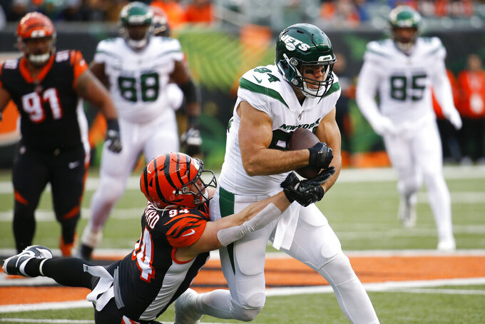 New York Jets tight end Ryan Griffin (84) runs the ball against Cincinnati Bengals defensive end Sam Hubbard (94) during the first half of an NFL football game, Sunday, Dec. 1, 2019, in Cincinnati. (AP Photo/Frank Victores)