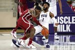 Oklahoma guard De'Vion Harmon (11) collides with TCU's Mike Miles (1) as he works the perimeter in the second half of an NCAA college basketball game in Fort Worth, Texas, Sunday, Dec. 6, 2020. (AP Photo/Tony Gutierrez)