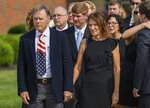 FILE - In this June 22, 2017, file photo, Fred and Cindy Warmbier watch as their son Otto's casket is placed in a hearse after his funeral Wyoming, Ohio. The Warmbier's have spoke out Friday, March 1, 2019, after President Donald Trump's comment this week that he takes North Korea's leader Kim Jong Un