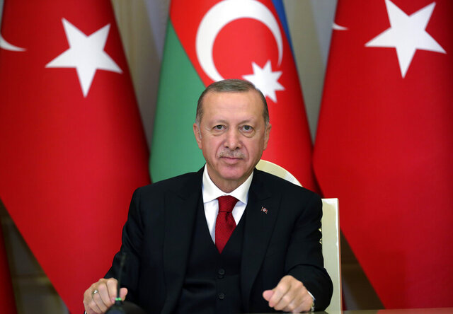 Turkey's President Recep Tayyip Erdogan talks during a joint news conference with Azerbaijan's President Ilham Aliyev, in Baku, Azerbaijan, Thursday, Dec. 10, 2020. Following the approval of European leaders Friday Dec. 11, 2020 of expanding sanctions against Ankara, Turkey called on the European Union to act as an 'honest mediator' in its dispute with EU members Greece and Cyprus over the exploration of gas reserves in the Mediterranean. The leaders said early Friday that Turkey has
