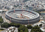 FILE - This July 11, 2018, aerial file photo shows New National Stadium for the Tokyo 2020 Olympics under construction, in Tokyo. An IOC inspection team began a routine tour of venues being built for the Tokyo Olympics on Tuesday, May 21, 2019, just days after an international labor union federation derided difficult working conditions at some sites. (Kyodo News via AP, File)