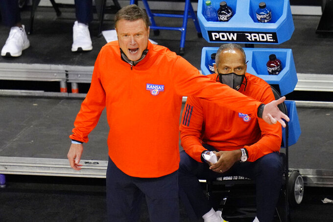 Kansas head coach Bill Self directs his team during the second half of a first-round game against Eastern Washington in the NCAA college basketball tournament at Farmers Coliseum in Indianapolis, Saturday, March 20, 2021. (AP Photo/AJ Mast)