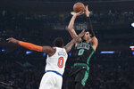 New York Knicks guard Kadeem Allen, left, guards Boston Celtics forward Jayson Tatum during the second half of an NBA basketball game, Friday, Feb. 1, 2019, at Madison Square Garden in New York. The Celtics won 113-99. (AP Photo/Mary Altaffer)