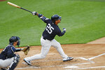 New York Yankees' Gleyber Torres follows through on his swing during an intrasquad baseball game Monday, July 6, 2020, at Yankee Stadium in New York. At left is catcher Kyle Higashioka. (AP Photo/Kathy Willens)
