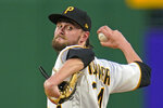 Pittsburgh Pirates starting pitcher JT Brubaker delivers during the third inning of the team's baseball game against the Los Angeles Dodgers in Pittsburgh, Tuesday, June 8, 2021. (AP Photo/Gene J. Puskar)