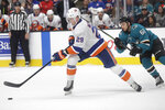 New York Islanders center Brock Nelson (29) reaches for the puck in front of San Jose Sharks right wing Kevin Labanc (62) during the second period of an NHL hockey game in San Jose, Calif., Saturday, Nov. 23, 2019. (AP Photo/Jeff Chiu)f