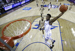 Duke's RJ Barrett (5) goes up to dunk against Florida State during the first half of the NCAA college basketball championship game of the Atlantic Coast Conference tournament in Charlotte, N.C., Saturday, March 16, 2019. (AP Photo/Chuck Burton)