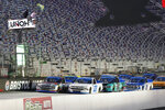 Grant Enfinger (98) and Brett Moffitt (23) lead the field at the start of the NASCAR Truck Series auto race Thursday Sept. 17, 2020, in Bristol, Tenn. (AP Photo/Steve Helber)