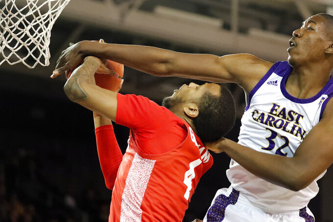 East Carolina's Charles Coleman (32) fouls Houston's Justin Gorham (4) while trying to block a shot during the first half of an NCAA college basketball game in Greenville, N.C., Wednesday, Jan. 29, 2020. (AP Photo/Karl B DeBlaker)