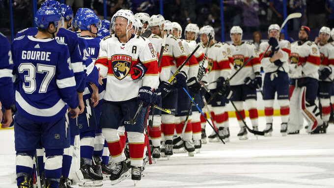 Florida Panthers right wing Patric Hornqvist (70) leads the team to congratulate the Tampa Bay Lightning after the Lightning defeated the Florida Panthers during Game 6 of an NHL hockey Stanley Cup first-round playoff series Wednesday, May 26, 2021, in Tampa, Fla. The Lightning won the series 4-2. (AP Photo/Chris O'Meara)