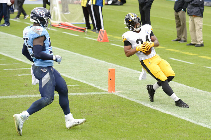 Pittsburgh Steelers running back Benny Snell (24) scores a touchdown ahead of Tennessee Titans inside linebacker Jayon Brown (55) in the first half of an NFL football game Sunday, Oct. 25, 2020, in Nashville, Tenn. (AP Photo/Mark Zaleski)