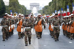 Soldiers of the French Foreign Legion parade on the Champs Elysees avenue during a rehearsal for Bastille Day, early Wednesday, July 11, 2018 in Paris. (AP Photo/Jean-Francois Badias)