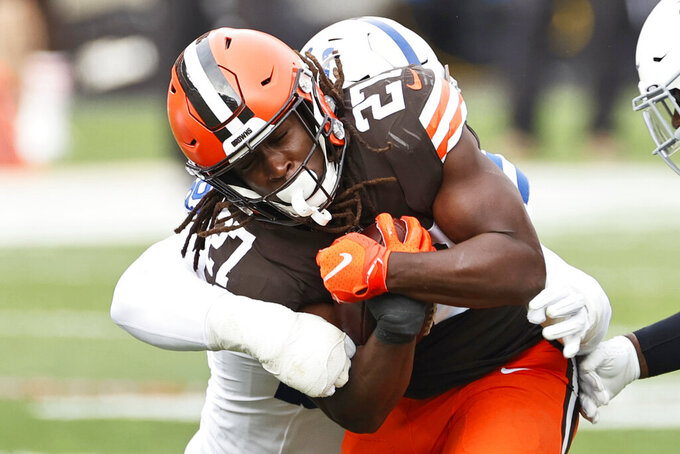 Cleveland Browns running back Kareem Hunt (27) rushes against the Indianapolis Colts during the first half of an NFL football game, Sunday, Oct. 11, 2020, in Cleveland. (AP Photo/Ron Schwane)
