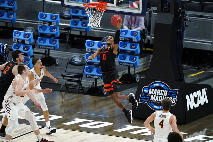 Oregon State guard Jarod Lucas (0) drives to the basket during the second half of a Sweet 16 game against Loyola Chicago in the NCAA men's college basketball tournament at Bankers Life Fieldhouse, Saturday, March 27, 2021, in Indianapolis. (AP Photo/Darron Cummings)