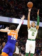 Boston Celtics' Jayson Tatum (0) shoots over Cleveland Cavaliers' Cedi Osman (16) in the first half of an NBA basketball game, Tuesday, March 26, 2019, in Cleveland. Boston won 116-106. (AP Photo/Tony Dejak)