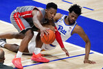 Pittsburgh's Femi Odukale, right, dives as Gardner Webb's Jaheam Cornwall, left, tries to control the ball during the first half of an NCAA college basketball game, Saturday, Dec. 12, 2020, in Pittsburgh. (AP Photo/Keith Srakocic)