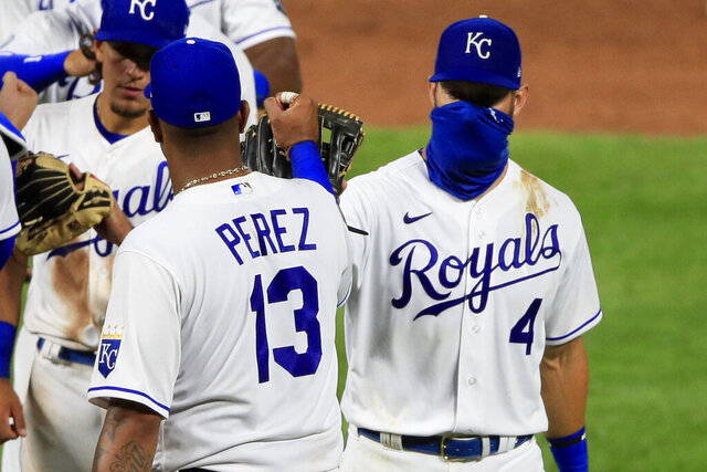 Kansas City Royals Salvador Perez (13) and Alex Gordon (4) celebrate following a baseball game against the Chicago Cubs at Kauffman Stadium in Kansas City, Mo., Thursday, Aug. 6, 2020. (AP Photo/Orlin Wagner)