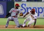 Los Angeles Angels second baseman Luis Rengifo (4) is unable to reach around to tag Texas Rangers' Delino DeShields, who stole second during the 11th inning of a baseball game in Arlington, Texas, Tuesday, Aug. 20, 2019. (AP Photo/Tony Gutierrez)
