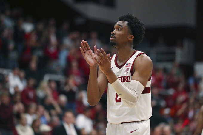 Stanford guard Bryce Wills (2) celebrates against Colorado during the second half of an NCAA college basketball game in Stanford, Calif., Sunday, March 1, 2020. (AP Photo/Jed Jacobsohn)