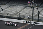 Josef Newgarden takes the checkered flag to win the IndyCar auto race at Indianapolis Motor Speedway in Indianapolis, Friday, Oct. 2, 2020. (AP Photo/Michael Conroy)