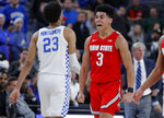 Ohio State's D.J. Carton (3) celebrates after a play against Kentucky during the second half of an NCAA college basketball game Saturday, Dec. 21, 2019, in Las Vegas. (AP Photo/John Locher)