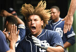 San Diego Padres' Josh Naylor celebrates in the dugout after hitting a home run against the Chicago Cubs during the eighth inning of a baseball game Friday, July 19, 2019, in Chicago. (AP Photo/David Banks)